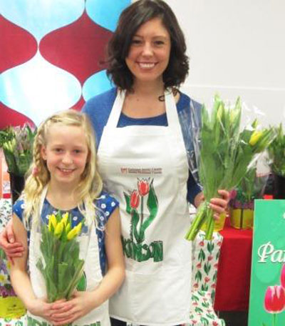 Volunteer Services Coordinator Elisabeth Schoep and her daughter Ella sell tulips for Parkinson Awareness Month.