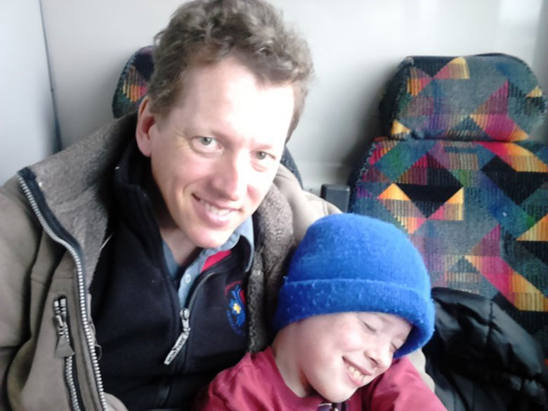 Dan Steele, with his son Michael (age 8) in 2015, five years after Dan was diagnosed with Parkinson's.