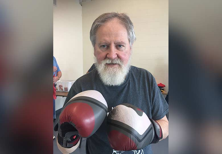 Dr. Harold Robertson in his local Parkinson's boxing program