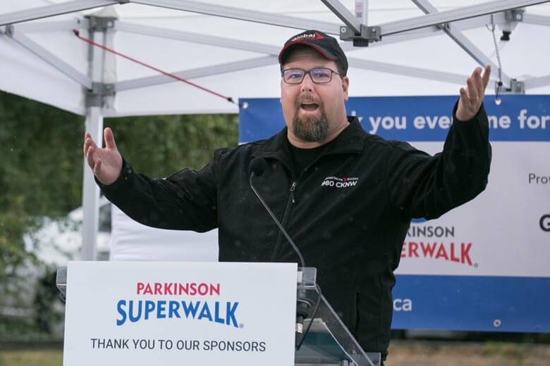 Larry Gifford, host of the podcast When Life Gives You Parkinson's, speaking at the Parkinson SuperWalk